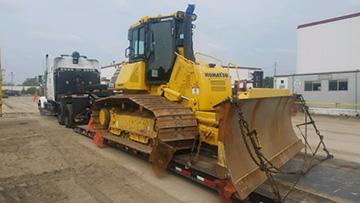 hauling a Komatsu D61-PX23 on a Gooseneck