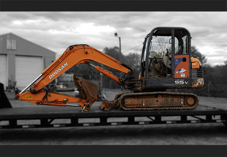 Mini Excavator Shipping Services | Heavy Haulers | (800) 908