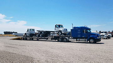 Transporting 2 International 440 Day Cabs