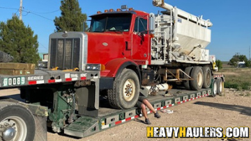 Transporting an ANFO truck on a trailer
