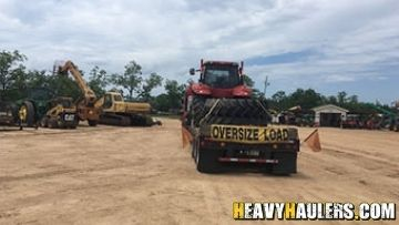 Oversized tractor being hauled