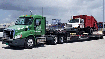 Transporting 2003 International 4900 Garbage Truck