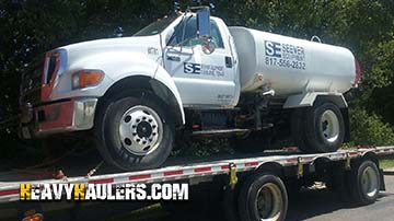 Tank Truck Being Towed
