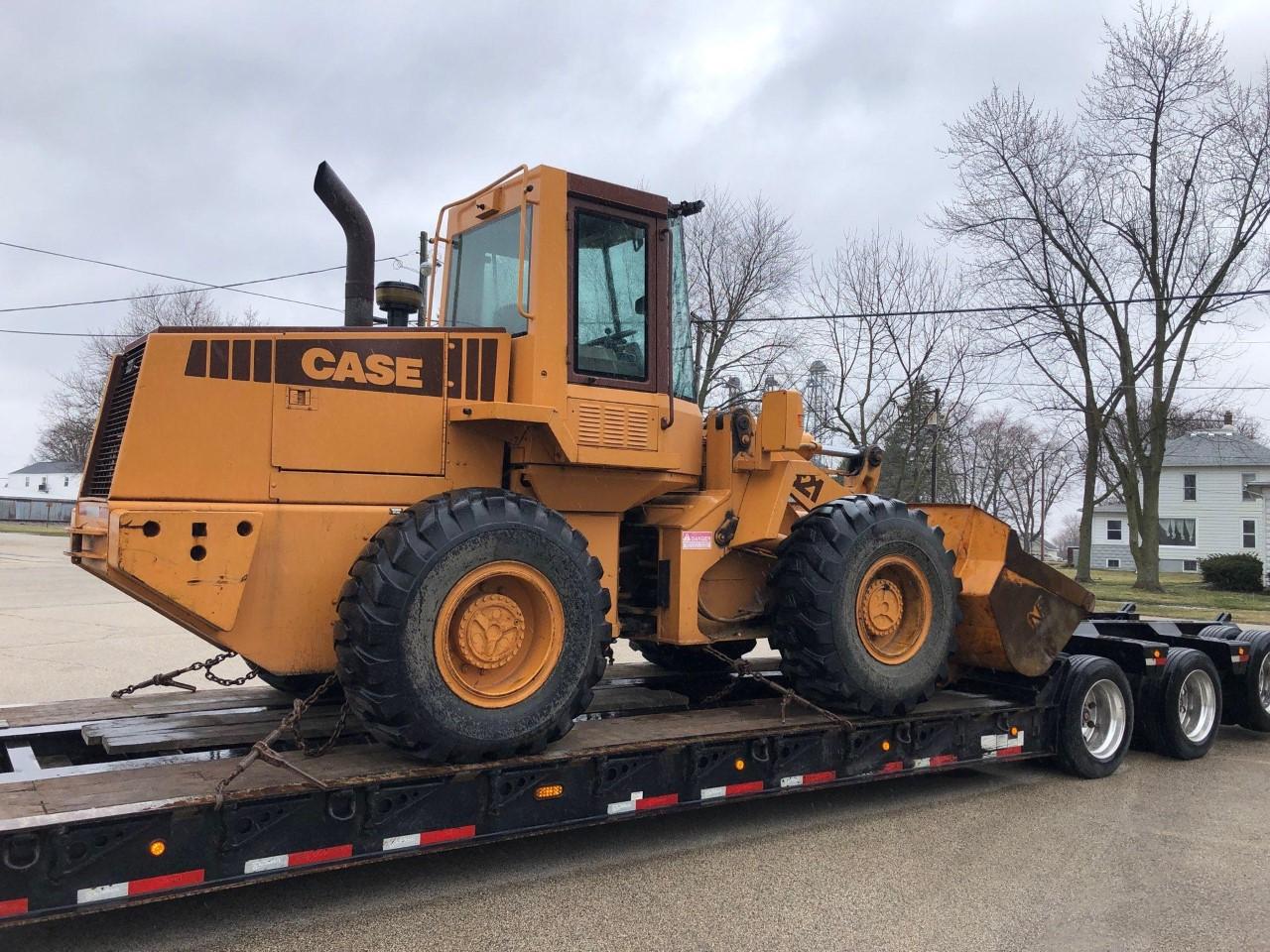 wheel loader in transport on a heavy haul trucking trailer