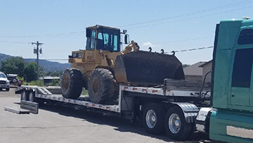 Hauling Caterpillar 936F Wheel Loader