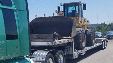 Transporting Caterpillar 936F Wheel Loader