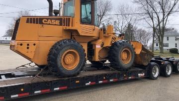 heavy haul trucking a wheel loader cross-country