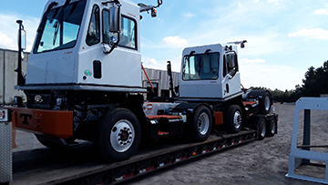 2019 TICO Spotter Trucks transported on an RGN trailer